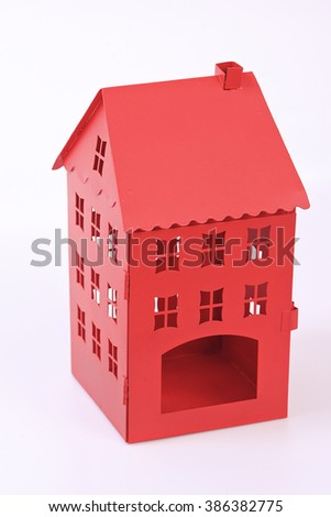 red toy house/ little red house/ red plastic house  - stock photo