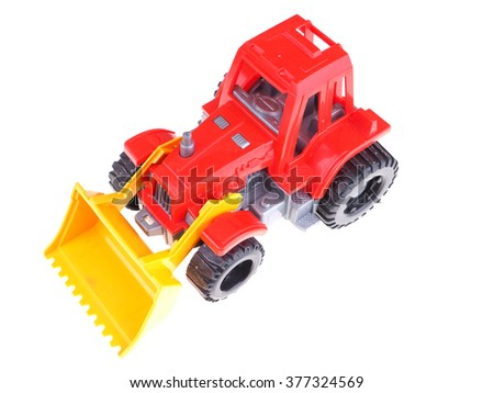 red toy tractor on a white background