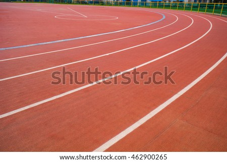 Red track in stadium for athlete, jogging, relax, walk and running