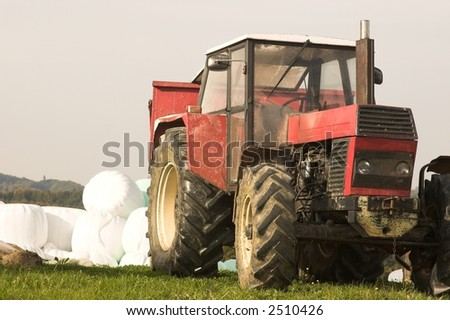 red tractor on green - stock photo