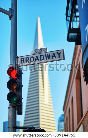Red traffic light and Broadway street sign in San Francisco, California, USA