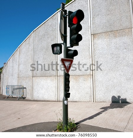 red traffic light in hot summer day - stock photo