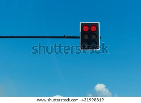 red traffic light on blue sky background - stock photo