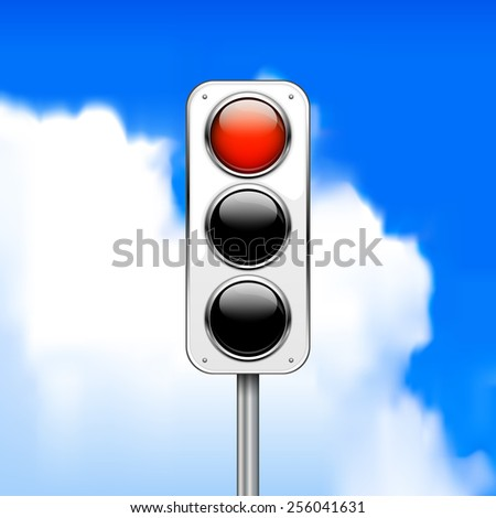 Red traffic light on sky background