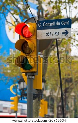 red traffic light, Passeig de Gracia, Bercelona, Spain - stock photo