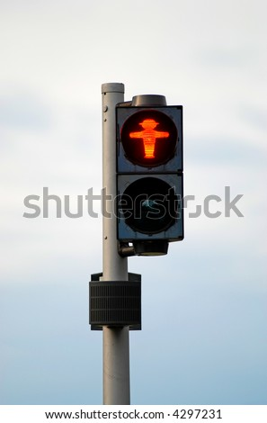 Red traffic light with funny figure - stock photo