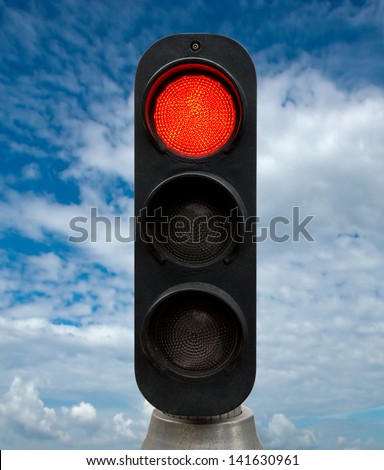 Red traffic lights against blue sky backgrounds. Clipping Path included. - stock photo