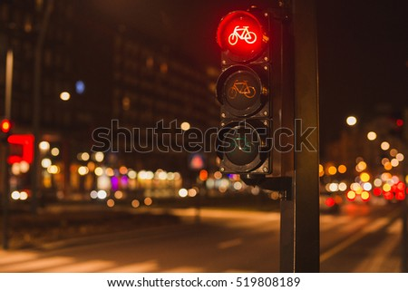 Red traffic lights for bicycles drivers in the evening city