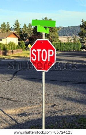 "Red traffic sign ""Stop"" on the house background"