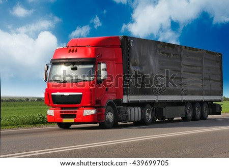 Red trailer on schosse. transport loads - stock photo