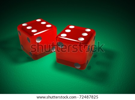 Red transparent dice on green surface