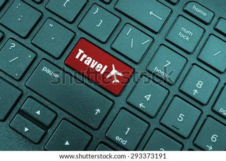 Red travel button on laptop keyboard - stock photo
