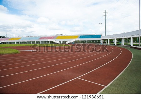 Red treadmill at the stadium. - stock photo