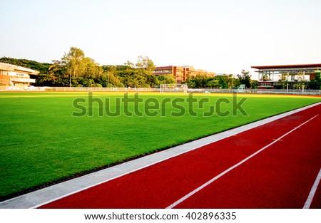 Red treadmill, track running at the stadium - stock photo