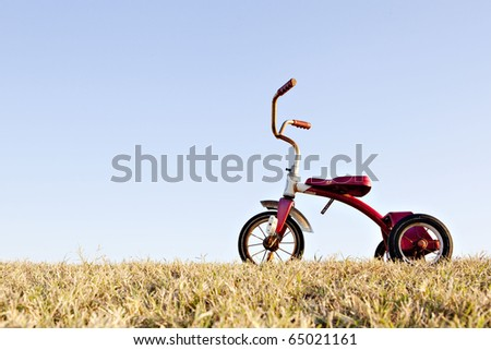 red tricycle - stock photo