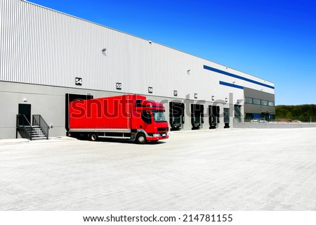 red truck at the warehouse building