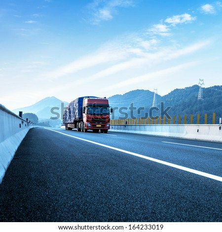 Red truck on the highway at high speeds. - stock photo