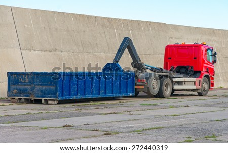 Red truck with a removable container. - stock photo