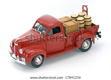 Red truck with barrels on isolated white - stock photo
