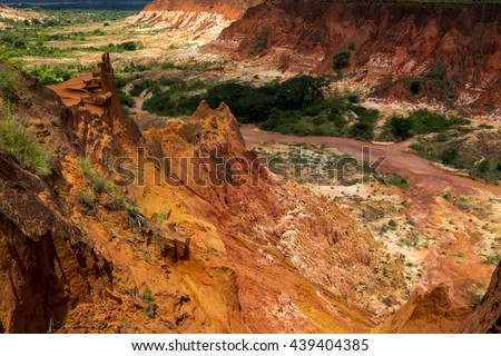 Red Tsingy - stone formation of red laterite formed by erosion of the Irodo River in the region of Diana in north of Madagascar. - stock photo