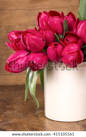 Red tulip flower in a vase - stock photo