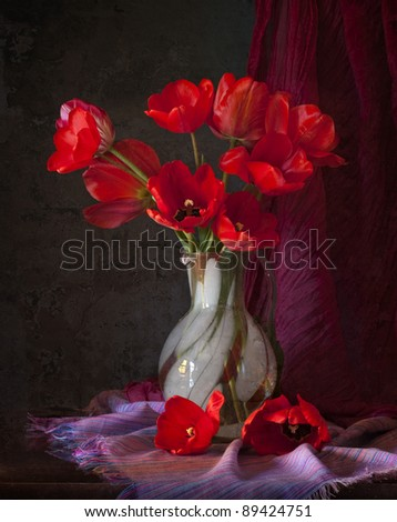 red tulips in a vase - stock photo