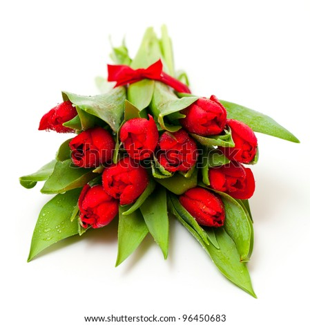 red tulips tied with a red ribbon - stock photo