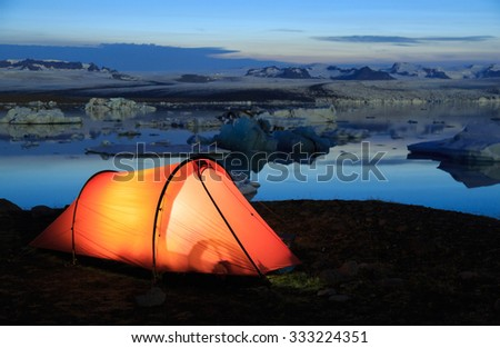 Red tunnel tent during the evening at the Jokulsarlon lagoon on Iceland. - stock photo