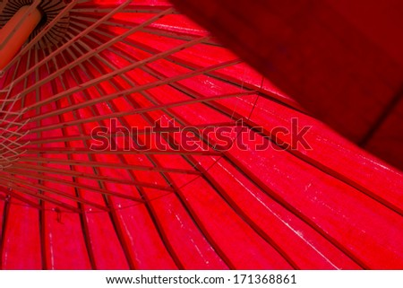 Red umbrella handmade on white background - stock photo