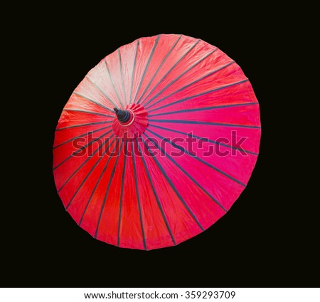 red umbrella isolated on black background - stock photo