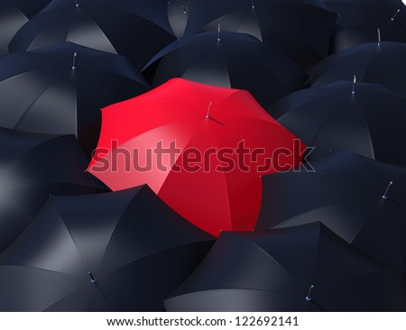 Red umbrella outstanding from black umbrellas. - stock photo