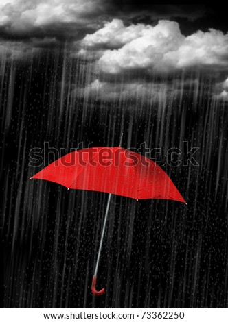 Red umbrella's in heavy rain to use as background - stock photo
