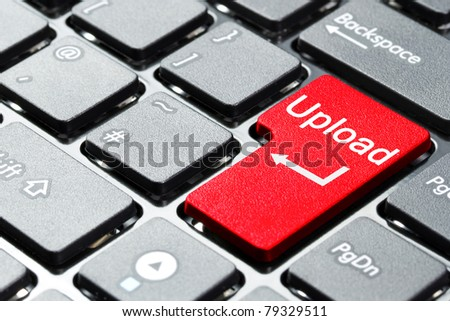 Red upload button on the keyboard - stock photo