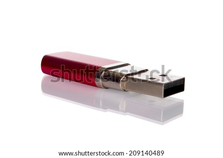 Red USB memory stick isolated on white - stock photo