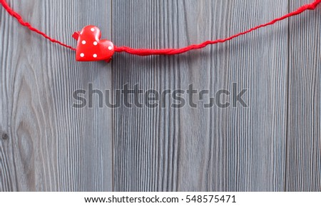 Red valentine heart, with wood background