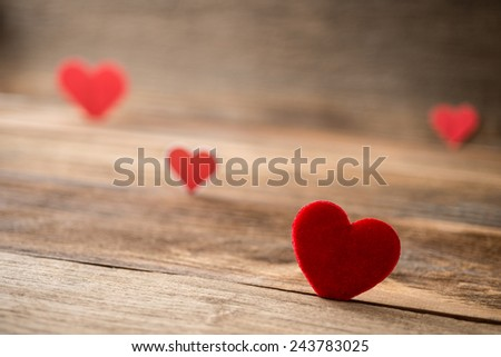 Red Valentine hearts on old rustic wooden background. Valentine's day. - stock photo