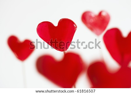 red valentine-style lollipops against a white background - stock photo