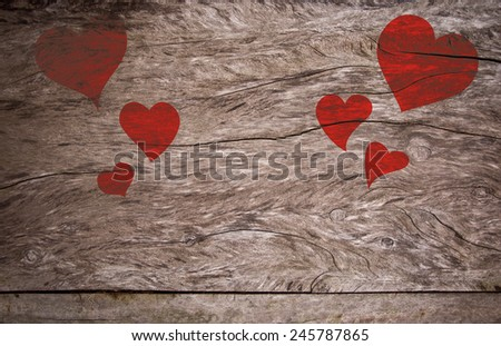 Red Valentines Day hearts on dark wood textured table - stock photo