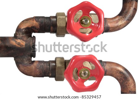 Red valves on copper  pipes - stock photo