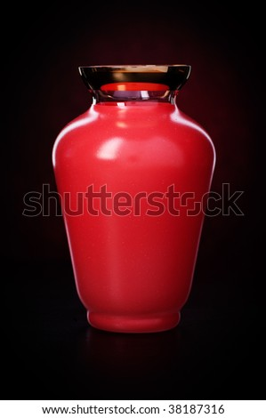 red vase on black background - stock photo