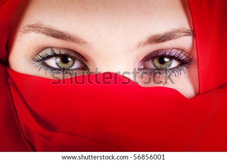 Red veil woman with beautiful sexy eyes - stock photo