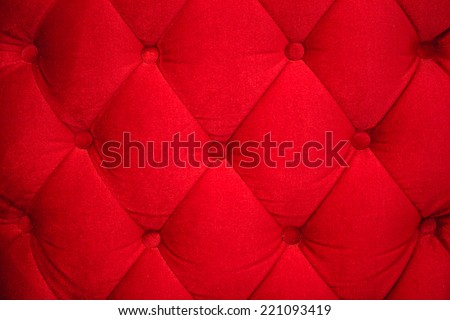Red velvet and button wall  - stock photo