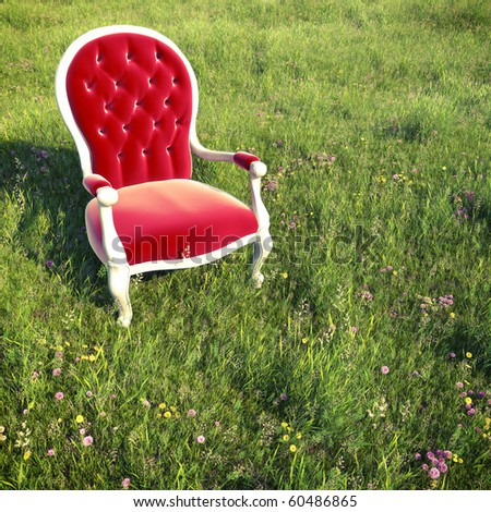 red velvet armchair alone on a flowery meadow with cross process effect for a dreamlike atmosphere