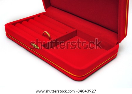 red velvet box with gold ring isolated on white background