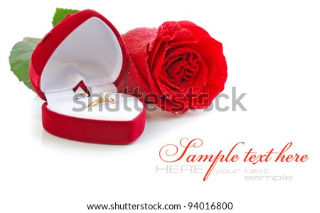 Red velvet box with golden ring and red rose on a white background - stock photo