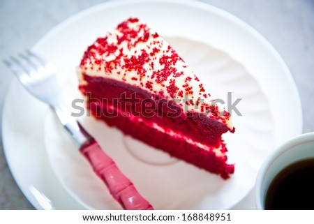 Red Velvet Cake on white plate  with coffee - stock photo