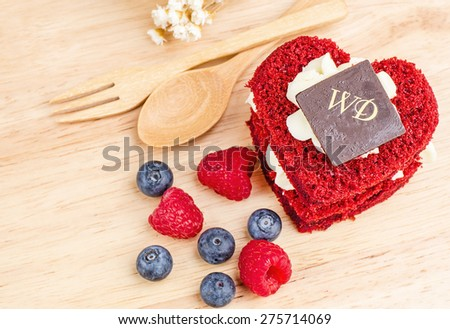 Red Velvet cake on wooden background, Shape of heart, raspberries and blueberrys. - stock photo
