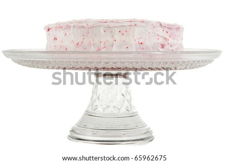 red velvet cake with pink frosting on a serving tray isolated over white - stock photo