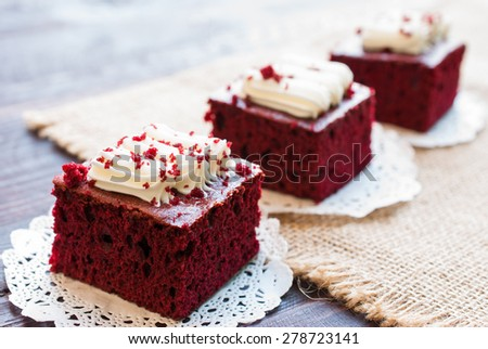 Red velvet cakes on wooden board - stock photo