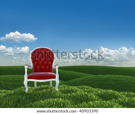 red velvet classic armchair in a green meadow of grass